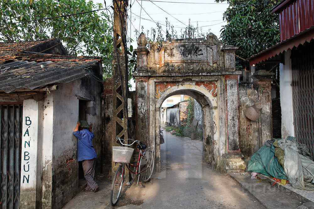 One of the few remaining gates of Thai Ha Village, which specializes in lacquer ware, Hanoi, Vietnam, Southeast Asia