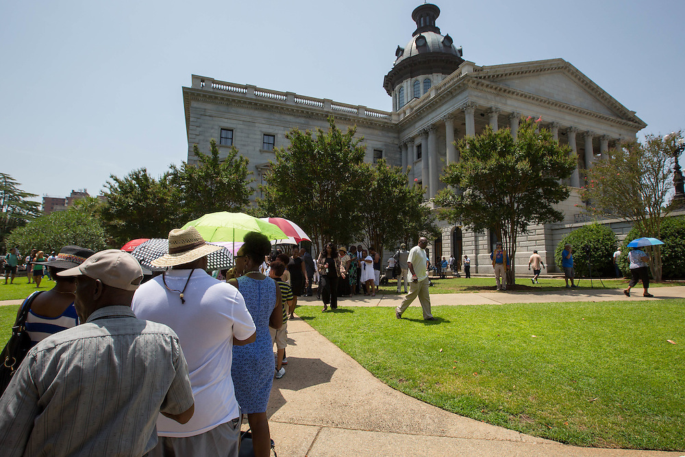 People wait in line at the South Carolina State House to view the body of Sen. Clementa Pinckney on June 24, 2015 in Columbia, South Carolina. Pinckney's body laid in state there for four hours. On June 17, 2015, nine people were shot and killed inside Emanuel African Methodist Episcopal Church in Charleston, South Carolina, where Pinckney was the pastor, during Bible study. A suspect, Dylann Roof, 21, was arrested in connection with the shootings. Photo by Kevin Liles/UPI