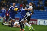 Junior Hoilett of Cardiff city is held back by Tim Ream of Fulham.  EFL Skybet championship match, Cardiff city v Fulham at the Cardiff city stadium in Cardiff, South Wales on Saturday 25th February 2017.<br /> pic by Andrew Orchard, Andrew Orchard sports photography.