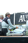 Team owner Ernesto Bertarelli sprays Moet and Chandon champagne in celebration of Alinghi's four nil victory over Oracle in the semi finals of the Louis Vuitton Cup 2002. (© Chris Cameron 2002)