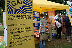 People  visiting the Gay and Bisexual Men's Health stand at Nottingham's 2005 Gay Pride Lesbian festival; held at the Arboretum,