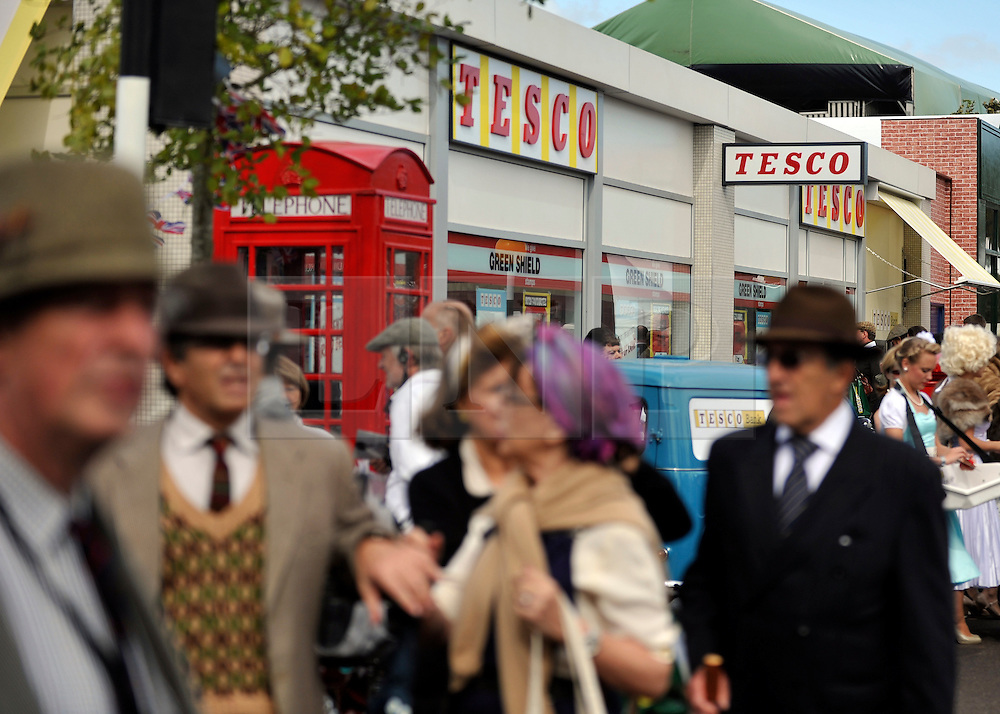 © Licensed to London News Pictures. 17/09/2011. GOODWOOD, UK. Tesco have recreated a 1960's store at The Goodwood Revival. The staff wore uniforms and hairstyles from the era and the shelves were stocked with household names in 60s packaging, whilst the last aisle was a modern day  'food to go' aisle. The fully operational store was making a brisk trade. The Goodwood Revival at Goodwood in West Sussex today (17 September 2011). The revival is the world's largest historic motor race meeting, which relieves the 'glorious' days of the race circuit. Competitors and enthusiasts all dress in period fashion to enhance the experience. Photo credit : Stephen Simpson/LNP