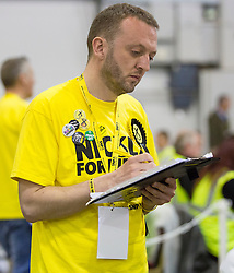 Scottish Parliament Election 2016 Royal Highland Centre Ingliston Edinburgh 05 May 2016; a SNP Count Agent keeps a watchful eye on the papers during the Scottish Parliament Election 2016, Royal Highland Centre, Ingliston Edinburgh.<br /> <br /> (c) Chris McCluskie | Edinburgh Elite media