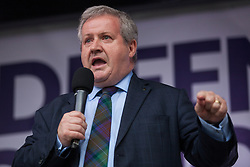 London, UK. 4 September, 2019. Ian Blackford, Leader of the Scottish National Party (SNP) in the House of Commons, addresses Remain supporters at a Defend Our Democracy rally in Parliament Square shortly after MPs passed the Brexit delay bill in the House of Commons.