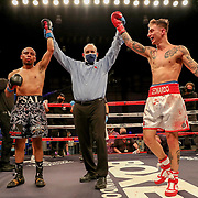 KISSIMMEE, FL - MARCH 05: Pedro Salome and John Leonardo fight to a draw during the Boxeo Telemundo All Star Boxing event at Osceola Heritage Park on March 5, 2021 in Kissimmee, Florida. (Photo by Alex Menendez/Getty Images) *** Local Caption *** Pedro Salome; John Leonardo