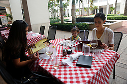 October 7, 2016 - Florida, U.S. - Seta Goldstein dines out with her daughter Olivia, 2, and friend Chelita Sabinson at Grimaldi's Pizzeria in Downtown at the Gardens Friday  afternoon after the passing of Hurricane Matthew, October 7, 2016 in Palm Beach Gardens. (Credit Image: © Yuting Jiang/The Palm Beach Post via ZUMA Wire)