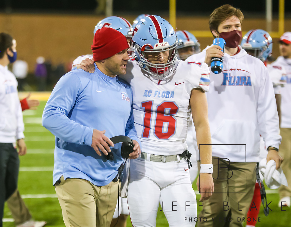 AC Flora Falcons head coach Dustin Curtis speaks with AC Flora Falcons quarterback Ethan Beamish (16) during the first half the state championship game at Benedict College.