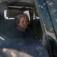 Kathy Collins, a resident of Blue Canyon, waits in her son's car at the end of the driveway for her Native American Resource transport to be taken to her dialysis appointment Friday. Her transport can not reach her home with the high snow fall blocking her in so her son would have to drive her to the main Blue Canyon road.