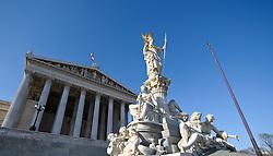 THEMENBILD - Wiener Eistraum, Eislaufen am Rathausplatz in Wien, das Bild wurde am 25. Jaenner 2012 aufgebommen, im Bild Parlament und Pallas Athene Statue mit blauem Himmel, AUT, EXPA Pictures © 2012, PhotoCredit: EXPA/ M. Gruber
