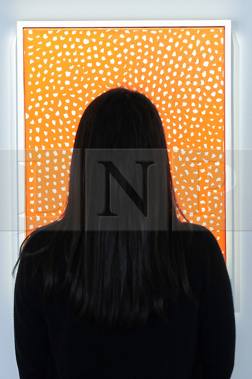 """© Licensed to London News Pictures. 17/02/2017. London, UK.   A staff member looks at """"Accretions"""" by Yayoi Kusama, at a preview of """"Traumata: Bourgeois/Kusama"""".  The joint exhibition is dedicated to the work of Louise Bourgeois and Yayoi Kusama, and takes place at Sotheby's S/2 Gallery 23 February to 13 April. Photo credit : Stephen Chung/LNP"""