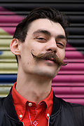Young man in his late-twenties street portrait with moustache.