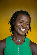 Portrait of a smiling young male local musician, Little Corn Island, Nicaragua