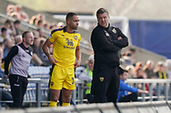 Oxford United manager Karl Robinson talk to Jordan Graham of Oxford United during the EFL Sky Bet League 1 match between Oxford United and Wycombe Wanderers at the Kassam Stadium, Oxford, England on 30 March 2019.