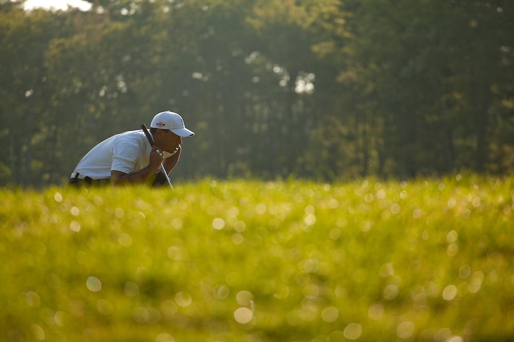 NORTON, MA - SEPTEMBER 4: Tiger Woods lines up a putt during the second round of the Deutsche Bank Championship at TPC Boston on September 4, 2010 in Norton, Massachusetts. (Photo by Darren Carroll/Getty Images) *** Local Caption *** Tiger Woods