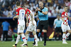 (L-R) Ivan Rakitic of Croatia, Marcelo Brozovic of Croatia, referee Nestor Pitana during the 2018 FIFA World Cup Russia Final match between France and Croatia at the Luzhniki Stadium on July 15, 2018 in Moscow, Russia