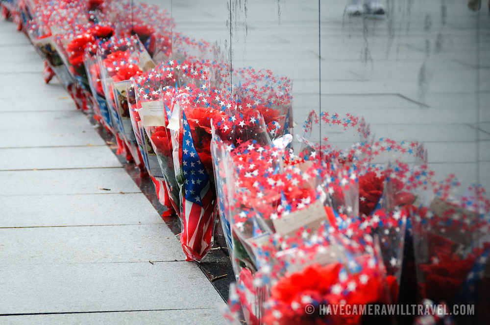 Hundreds of bunches of flowers line the reflecting wall of the Korean War Veterans Memorial on the National Mall in Washington DC.