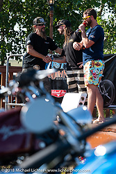 Christian Newman gets an award from Pat Patterson on stage at Pat's Sportster Showdown Bike Show presented by Led Sled and Biltwell at the Buffalo Chip during the 78th annual Sturgis Motorcycle Rally. Sturgis, SD. USA. Tuesday August 7, 2018. Photography ©2018 Michael Lichter.
