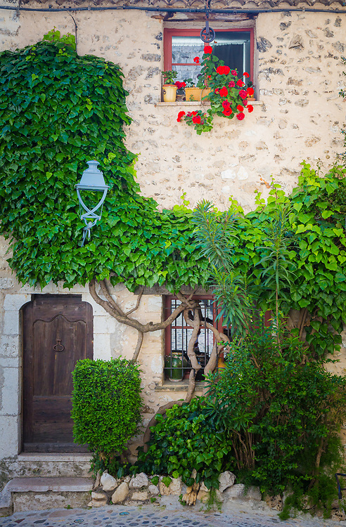 """House in Saint Paul de Vence in France.<br /> -----<br /> Saint-Paul or Saint-Paul-de-Vence is a commune in the Alpes-Maritimes department in southeastern France. One of the oldest medieval towns on the French Riviera, it is well known for its modern and contemporary art museums and galleries such as Fondation Maeght which is located nearby. It was probably between the 10th and 12th century that a settlement formed around the ancient church of Saint Michel du Puy to the south, and near the castle on the highest part of the hill. In the Middle Ages, the region was administered by the Counts of Provence. In the 13th century, Count Charles II granted more privileges to St. Paul, including the right to hold a weekly market. At the beginning of 14th century, St. Paul acquired more autonomy and became a prosperous city of merchants and nobility. In 1388, the County of Nice broke off from Provence to reattach itself with the states belonging to the Count of Savoy. These new circumstances gave St. Paul a strategic position: the city becomes a border stronghold for five centuries. St. Paul went through its first fortification campaign in the second half of 14th century: the north gate of the city, called """"Porte de Vence,"""" dates back to the medieval wall. At the time of the wars of Italy, Provence was invaded twice by the troops of Charles V. Considering the low side of the border of Provence and the obsolescence of the medieval fortifications in Saint-Paul, Fran�ois 1st decided in 1538 to build the new city walls, able to withstand the power of the artillery. This fortified wall, built between 1543 and 1547, is preserved in its entirety. On its northern and southern fronts four solid bastions protect both the city gates. In the 17th century, Saint-Paul experienced a religious period through the influence of Antoine Godeau, Bishop of Vence. The church was elevated to college, and was expanded and embellished. St. Paul also saw an urban revival thanks to the families of nobili"""