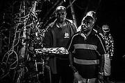 NOUVELLE CALEDONIE, Canala - Coutume du mariage Kanak -1 jour avant le mariage coutumier -La derniere etape des coutumes prealables au mariage est l'entree des tontons maternels de l'epoux. Dans la culture Kanak, les oncles maternel occupent une place preponderente car c'est par la mere et donc par son clan qu'est procure le sang et la vie des individus. Cette derniere entree est la plus importante et conclu l'ordre des entrees. Apres avoir presente la coutume,  ce sont eux qui prendront le relais des echanges coutumier pour la cermonie du lendemain -  Aire Coutumiere de XARACUU - Canala - Tribu de Nanon-Kenerou - Le Caillou - Septembre 2013