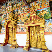 The ornate main doors at Wat Phonxay Sanasongkham in Luang Prabang, Laos.