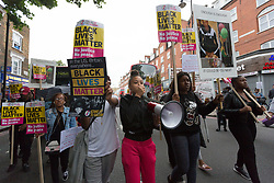 © Licensed to London News Pictures. 24/07/2017. LONDON, UK. Protesters from Stand Up To Racism join local Hackey supporters to stage a protest vigil outside Stoke Newington Police Station and block the road following the death of Rashan Charles. Police pursued Rashan Charles on foot after attempting to stop a car in Kingsland Road in the early hours of Saturday morning and after after entering a shop, Rashan Charles was seen trying to swallow an object and was then taken ill. Rashan Charles died in hospital around an hour later. Photo credit: Vickie Flores/LNP