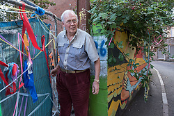 © Licensed to London News Pictures. 24/09/2019. Bristol, UK. Picture of the landlord owner exiting the site (did not give name). Bailiffs from EAS Enforcement with the landlord and agents and police present, and being filmed by Channel 5 for television, attempt an eviction at 26 Picton Lane, Montpelier. A resident (in flat cap) can be seen on the roof of a van and building as bailiffs use a scissor lift to try and access the roof, after supporters of the resident try and block the lift from being brought to the site. Photo credit: Simon Chapman/LNP.