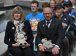 Pictured: Green MSP's Alison Johnstone and Patrick Harvie with child's toys to symbolise the lives lost on the roads.<br /> <br /> Protesters rallied outside the Scottish Parliament as the bill by Mark Ruskell to introduce a 20mph safer streets bill nationwide is set to be debated in the parliament this week.<br /> <br /> © Dave Johnston / EEm
