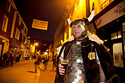 Lewes, UK. Monday 5th November 2012. Member of Cliffe bonfire society dressed as a viking has a pre parade drink. Bonfire Night celebration in the town of Lewes, East Sussex, UK which form the largest and most famous Guy Fawkes Night festivities. Held on 5 November, the event not only marks the date of the uncovering of the Gunpowder Treason and Plot in 1605, but also commemorates the memory of the 17 Protestant martyrs from the town burnt at the stake for their faith during the Marian Persecutions of 1555–57. There are six bonfire societies putting on parades involving some 3,000 people.