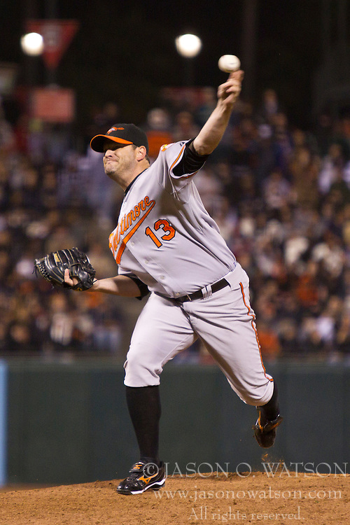 June 15, 2010; San Francisco, CA, USA;  Baltimore Orioles relief pitcher Will Ohman (13) pitches against the San Francisco Giants during the eighth inning at AT&T Park.