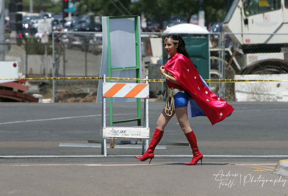 """Andrew Foulk/ Zuma Press.July 23, 2009, San Diego, California, USA. Comic Con. Comic Con  A women walks across the street dressed as """"Wonder Women"""" on her way to the San Diego convention center, during day one of the 40th annual San Diego International Comic Con."""