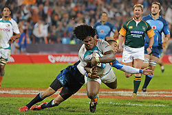 PRETORIA, South Africa, 28 May 2011. Ashley Johnson of the Cheetahs goes over for his second try with Bjorn Basson of the Bulls too late to stop him during the Super15 Rugby match between the Bulls and the Cheetahs at Loftus Versfeld in Pretoria, South Africa on 28 May 2011..Photographer : Anton de Villiers / SPORTZPICS