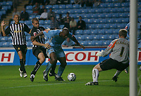 Photo: Steve Bond.<br />Coventry City v Notts County. The Carling Cup. 14/08/2007. Dele Adebola (C) buldozes through the Notts County defence