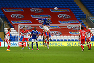 Cardiff City's Kieffer Moore (10) heads clear during the EFL Sky Bet Championship match between Cardiff City and Millwall at the Cardiff City Stadium, Cardiff, Wales on 30 January 2021.