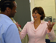 Cheri Booth QC speaks to one of the prisoners who is undertaking media traininig at the prisons community radio station, Radio Wanno.  Cheri Booth launched the the training project in 2004. HMP Wandsworth, London, United Kingdom