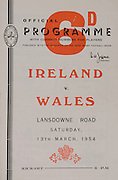 Irish Rugby Football Union, Ireland v Wales, Five Nations, Landsdowne Road,  Dublin, Ireland, Saturday 13th March, 1954,.13.3.1954, 3.13.1954,..Referee- A W C Austin, Scottish Rugby Union, ..Score- Ireland 9 - 12 Wales,..Irish Team, ..P Berkery, Wearing number 15 Irish jersey, Full back, Landsdowne Rugby Football Club, Dublin, Ireland,..M Mortell, Wearing number 14 Irish jersey, Right wing, Bective Rangers Rugby Football Club, Dublin, Ireland, ..N J Henderson, Wearing number 13 Irish jersey, Right centre, N.I.F.C, Rugby Football Club, Belfast, Northern Ireland,..R P Godfrey, Wearing number 12 Irish jersey, Left Centre, University College Dublin Rugby Football Club, Dublin, Ireland,..J T Gaston, Wearing number 11 Irish jersey, Left wing, Dublin University Rugby Football Club, Dublin, Ireland, ..S Kelly, Wearing number 10 Irish jersey, Stand Off, Landsdowne Rugby Football Club, Dublin, Ireland, ..J A O'Meara, Wearing number 9 Irish jersey, Scrum half, Dolphin Rugby Football Club, Cork, Ireland, ..J H Smith, Wearing number 1 Irish jersey, Forward,  London Irish Rugby Football Club, Surrey, England, ..R Roe, Wearing number 2 Irish jersey, Forward, Dublin University Rugby Football Club, Dublin, Ireland,..F E Anderson, Wearing number 3 Irish jersey, Forward, Queens University Rugby Football Club, Belfast, Northern Ireland,..J R Brady, Wearing number 4 Irish jersey, Forward, C I Y M S Rugby Football Club, Belfast, Northern Ireland, ..R H Thompson, Wearing number 5 Irish jersey, Forward, Instonians Rugby Football Club, Belfast, Northern Ireland, ..J S McCarthy, Wearing number 6 Irish jersey, Captain of the Irish team, Forward, Dolphin Rugby Football Club, Cork, Ireland, ..R Kavanagh, Wearing number 7 Irish jersey, Forward, Wanderers Rugby Football Club, Dublin, Ireland, ..G Reidy, Wearing number 8 Irish jersey, Forward, Dolphin Rugby Football Club, Cork, Ireland, and, Landsdowne Rugby Football Club, Dublin, Ireland,  ..Welsh Team, ..V Evans, Wearing number 1 Welsh jersey, F