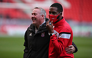 Ipswich Town Manager Paul Lambert  shares a joke with a Doncaster Rovers player before  the EFL Sky Bet League 1 match between Doncaster Rovers and Ipswich Town at the Keepmoat Stadium, Doncaster, England on 20 October 2020.