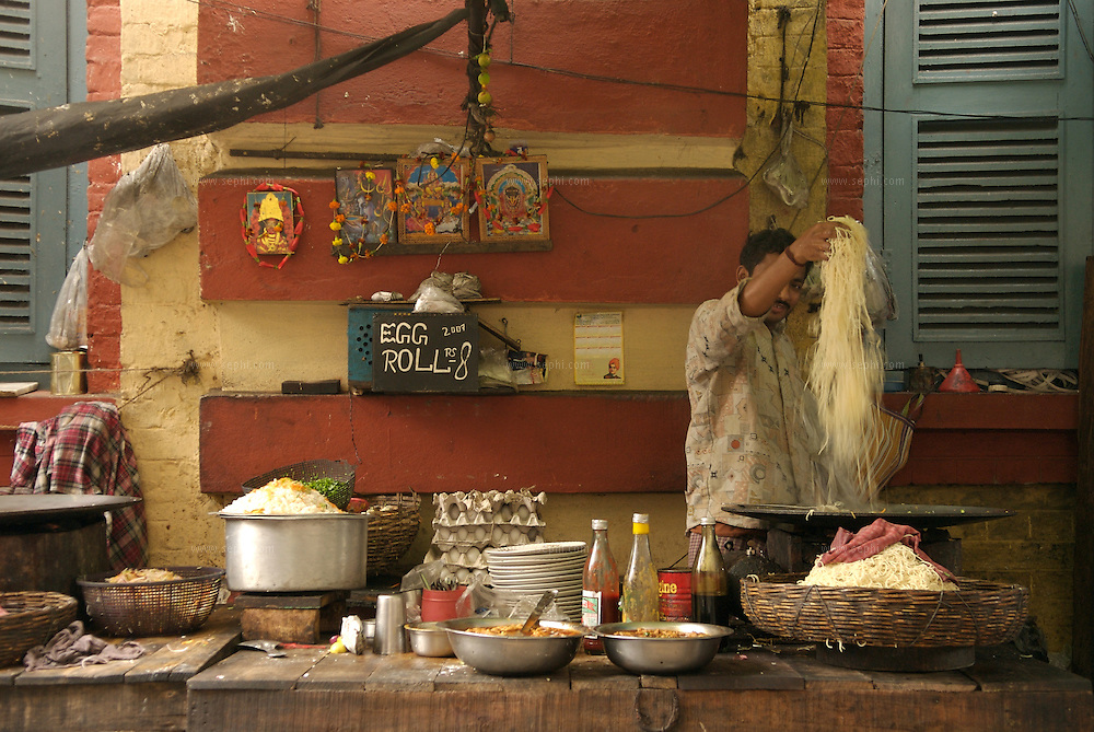A man preparing Chow Mein at a  food stall selling Chinese food in Kolkata, January 2007