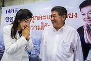 "03 MARCH 2013 - BANGKOK, THAILAND: <br /> YINGLUCK SHINAWATRA, the Thai Prime Minister, (left) ""wais"" (formal Thai greeting) other members of the Pheu Thai party leadership after announcing that Pongsapat Pongchareon (whose photo is on the billboard in the background) lost the Bangkok Governor's election. Pongsapat Pongchareon, running on the Pheu Thai ticket, lost the Bangkok's Governor's race to MR Sukhumbhand Paribatra, the incumbent running on the Democrat ticket. Sukhumbhand won the race after scoring a record number of votes, more than 1.2 million to Pongsapat's 1 million. The results were seen as an upset even though Sukhumbhand was the incumbent because all of the pre-election polls and the exit polls conducted on election day showed Patsapong winning.     PHOTO BY JACK KURTZ"