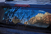 USA, Utah, Zion National Park, Zion Canyon reflected in the window of a Jeep Patriot