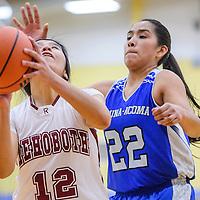 Rehoboth Lynx Ashley Abeita (12) gets around Laguna Acoma Hawk Talia Pantiamo (22) for a shot Tuesday at Rehoboth High School.