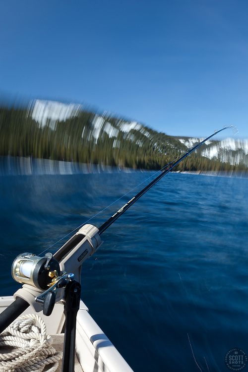 """""""Fishing Pole at Lake Tahoe 9"""" - Photograph of a fishing pole on Lake Tahoe, CA. The seasick motion effect was achieved by using a tripod on the moving boat with a long exposure."""
