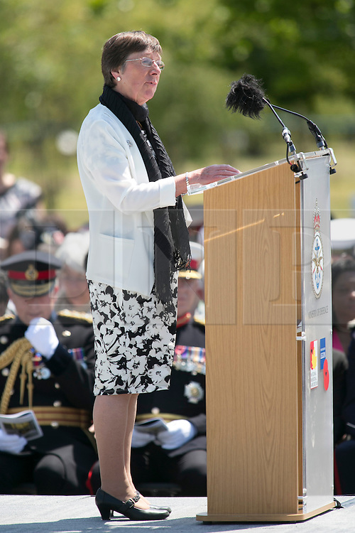 © Licensed to London News Pictures. 11/06/2015. National Memorial Arboretum, Alrewas, Staffordshire, UK. The service to mark the Rededication of the Bastion Memorial. The memorial was begun in Helmand Province in 2006, deconstructed in 2014 and now replicated at the National Memorial Arboretum in Staffordshire. Around two thousand people took part in the service including HRH Prince Harry, the Prime Minister David Cameron and senior members of the Armed Forces. Pictured, MRS JACQUELINE HOLLOWAY mother of Captain Richard Holloway giving a speech. Photo credit : Dave Warren/LNP