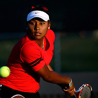 050814       Adron Gardner<br /> <br /> Grants Pirate Paris Corley lines up a swing to number two ranked Albuquerque Academy Charger Dani Apodaca for the 4A girls state tennis championship at the Jerry Cline Tennis Complex in Albuquerque Thursday.