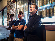 12 SEPTEMBER 2019 - CLIVE, IOWA: Governor STEVE BULLOCK (D-MT), right, and members of his campaign team, waits to talk to Iowa voters at a campaign event in a microbrewery in Clive, IA, a suburb of Des Moines. Gov. Bullock is vying to be the Democratic party's nominee in 2020. He is campaigning in Iowa this week because he didn't qualify for the September 12 debate. Iowa traditionally hosts the the first election event of the presidential election cycle. The Iowa Caucuses will be on Feb. 3, 2020.                PHOTO BY JACK KURTZ
