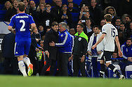 Tottenham manager Mauricio Pochettino (l) argues with Chelsea manager Guus Hiddink ® after Chelsea score their 2nd goal. Barclays Premier league match, Chelsea v Tottenham Hotspur at Stamford Bridge in London on Monday 2nd May 2016.<br /> pic by Andrew Orchard, Andrew Orchard sports photography.