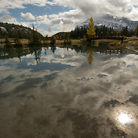 Hikers enjoy a fall day & view of Mount Rundle at Cascade Ponds in Alberta, Canada's Banff National Park.