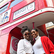 Norma Shakes and Perri Shakes-Drayton is a GB Olympic athlete attend Brigits Bakery host their Pink Ribbon Afternoon Tea in aid of the Pink Ribbon Foundation, London, UK. 16 October 2018.