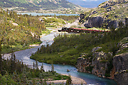 The historic steam engine number 73 of the White Pass and Yukon Route railroad passing through White Pass British Columbia, Canada, from Skagway, Alaska.