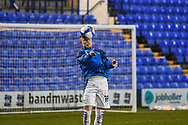 Tranmere Rovers defender Calum MacDonald warms up during the EFL Sky Bet League 2 match between Tranmere Rovers and Forest Green Rovers at Prenton Park, Birkenhead, England on 19 January 2021.