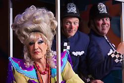 """© Licensed to London News Pictures. 11/12/2012. London, England. Lily Savage/Paul O'Grady as the Widow Twankey with the policemen Matthew Rixon as Ping and Andy Spiegel as Pong. Lily Savage, aka Paul O'Grady, stars as the Widow Twankey in the Christmas panto """"Aladdin, A Wish Come True"""" at the Theatre at the O2, O2 Arena, London. Photo credit: Bettina Strenske/LNP"""